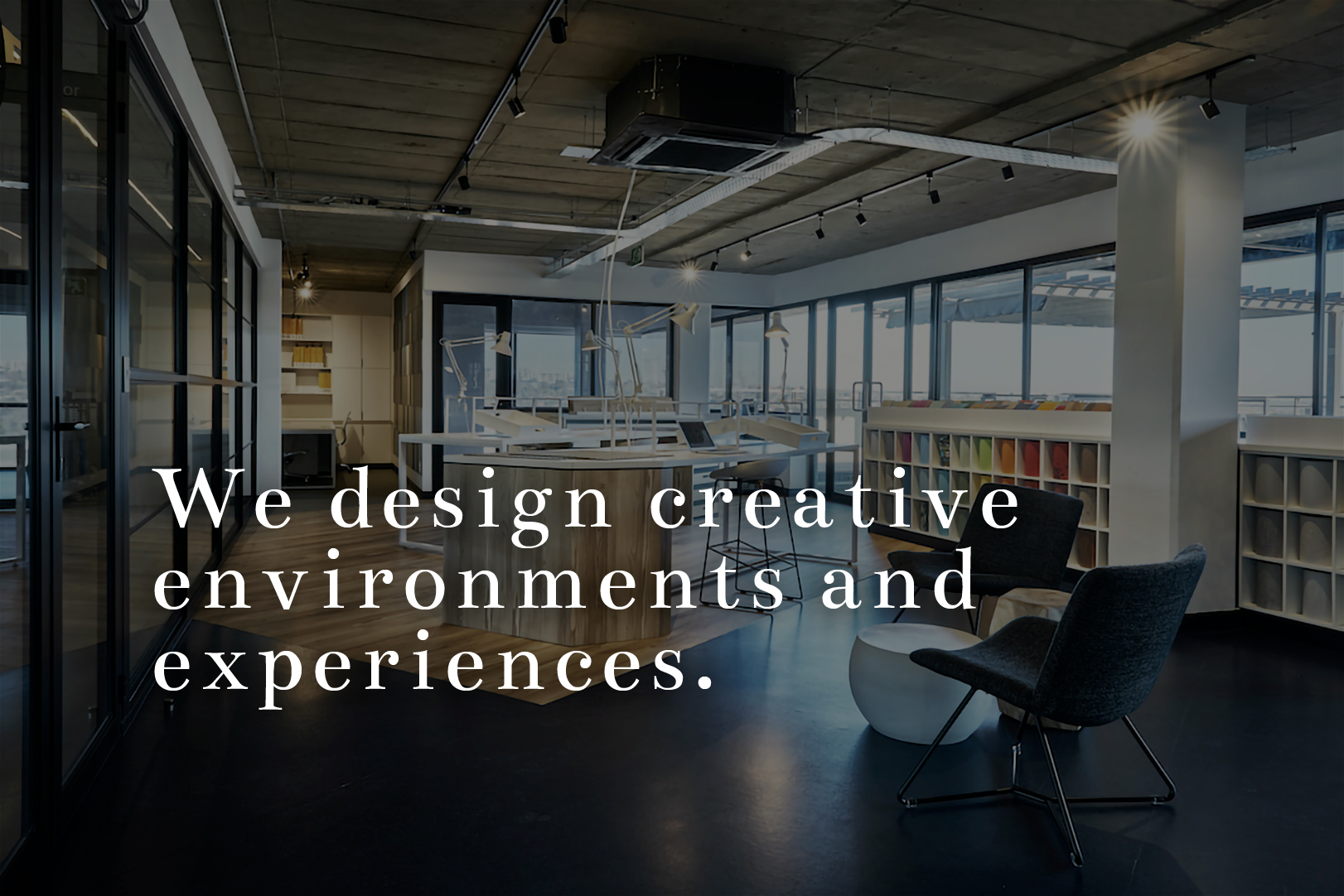 8a Creative Hero image with tagline - We design creative environments and experiences